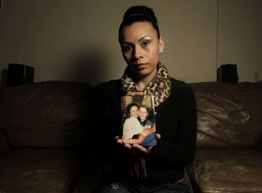 Erica Aguilar, who was like a second mother to Raquel Gerstel, holds a middle school photograph of Raquel and Bobbie Sertain, while at the home of Raquel's father in San Leandro, Calif. on Jan. 3, 2013. Raquel and her friend Bobbie were shot and killed in a double homicide in Oakland, Ca. on Nov. 25, 2012. Photo: Michael Macor, The Chronicle