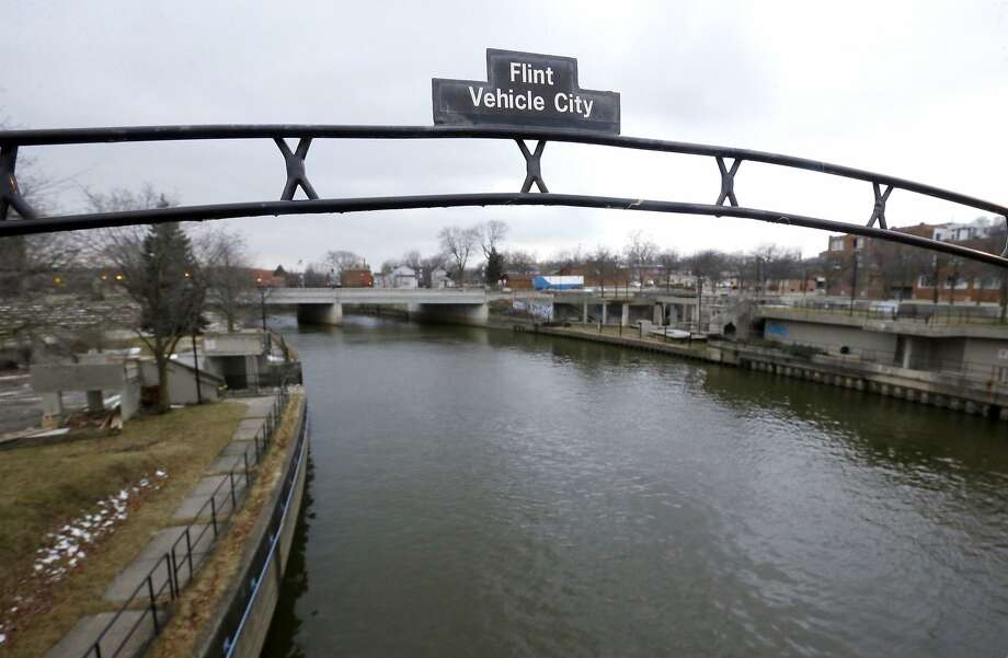 This Jan. 26, 2016 file photo shows a sign over the Flint River noting Flint, Mich., as Vehicle City. The state of Michigan will pay all Flint water bills in May to encourage the flushing of lead from old pipes and the recoating of plumbing with a corrosion chemical. Photo: Carlos Osorio, Associated Press