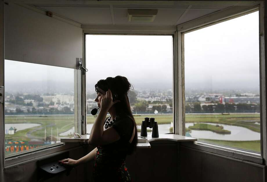 Angela Hermann, the first full-time female race-caller in the U.S., works in her booth above the race track at Golden Gate Fields May 7, 2016 in Berkeley, Calif. Photo: Leah Millis, The Chronicle