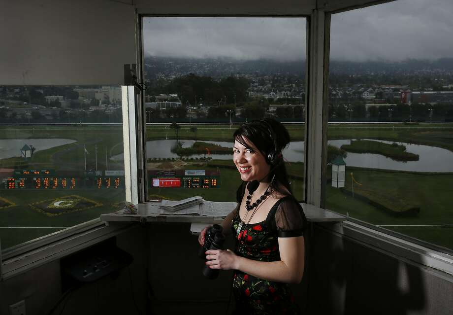 Angela Hermann, the first full-time female race-caller in the U.S., pictured in her booth above the race track at Golden Gate Fields May 7, 2016 in Berkeley, Calif. Photo: Leah Millis, The Chronicle