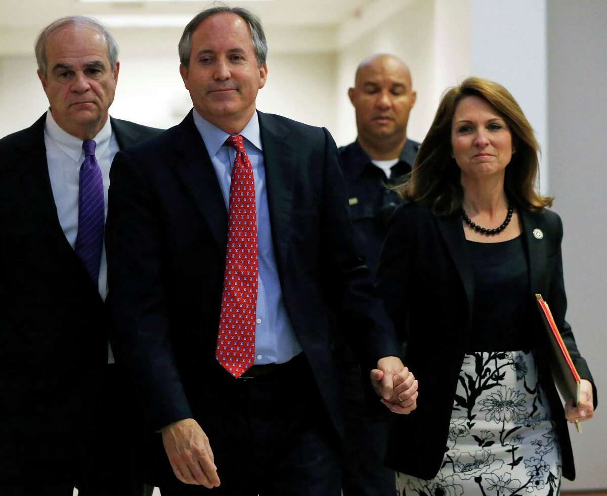 Texas Attorney General Ken Paxton, second from left, and his wife Angela Paxton, right, enter the Merrill Hartman Courtroom in the Fifth Court of Appeals at the George Allen Courts Building in Dallas, Thursday May 12, 2016. Paxton's legal team recently loss an attempt at an appeals court to toss criminal charges he defrauded investors. Paxton also faces separate civil fraud charges filed by the U.S. Securities and Exchange Commission. (Rose Baca/The Dallas Morning News via AP)