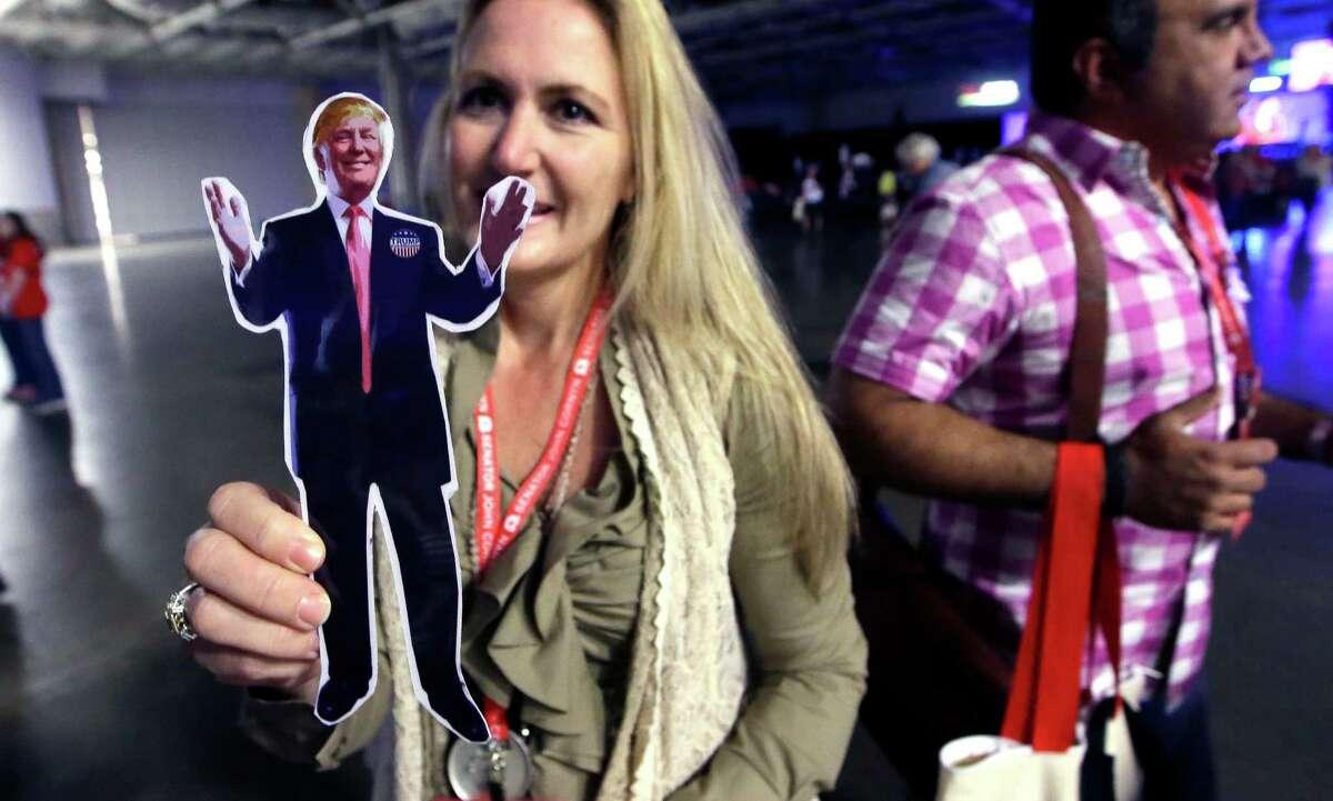 Texas Republican Convention delegate Donna Warren Renteria shows off a cutout of Donald Trump.