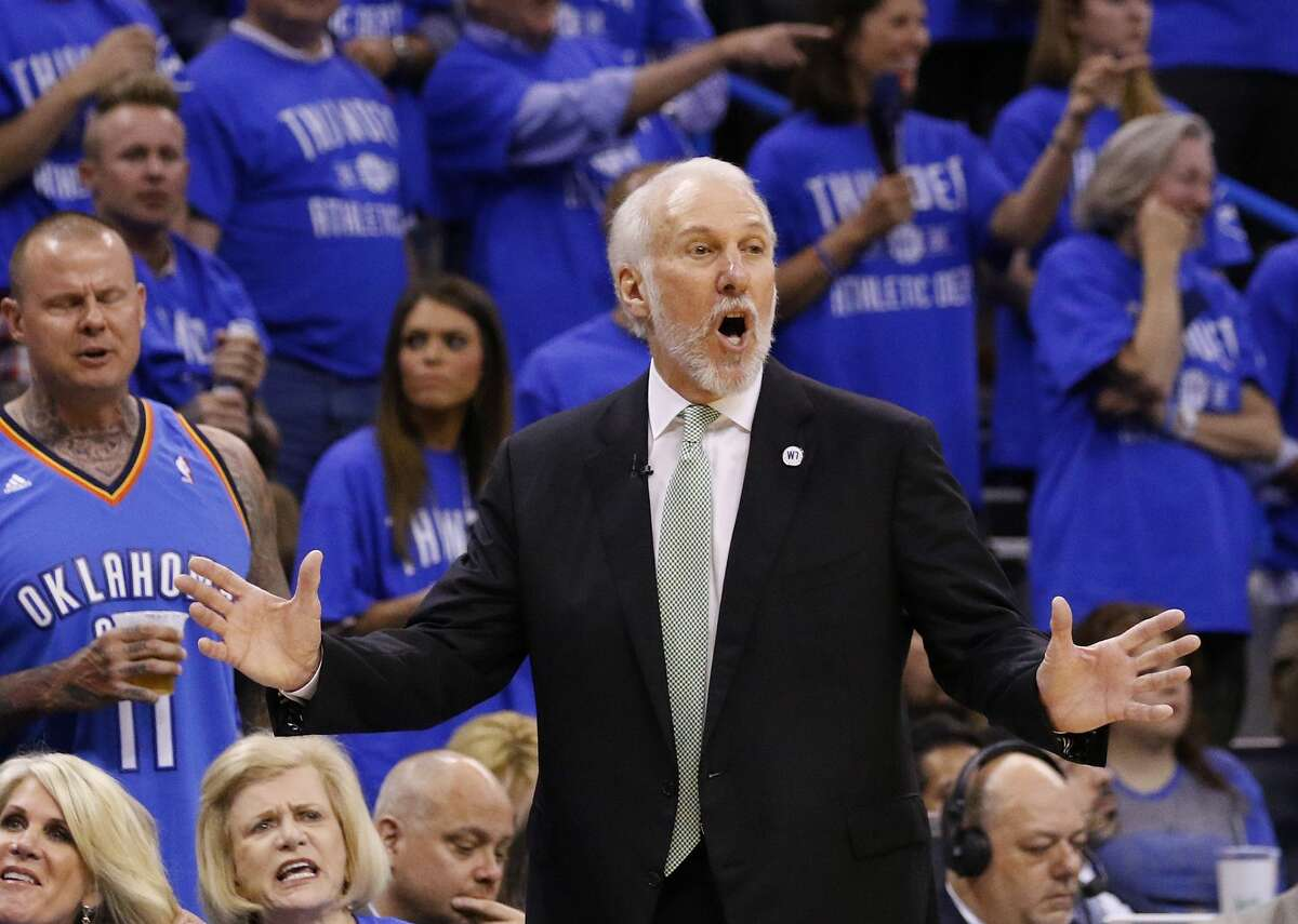 San Antonio Spurs head coach Gregg Popovich gestures in the first quarter of Game 6 of a second-round NBA basketball playoff series against the Oklahoma City Thunder in Oklahoma City, Thursday, May 12, 2016. (AP Photo/Alonzo Adams)