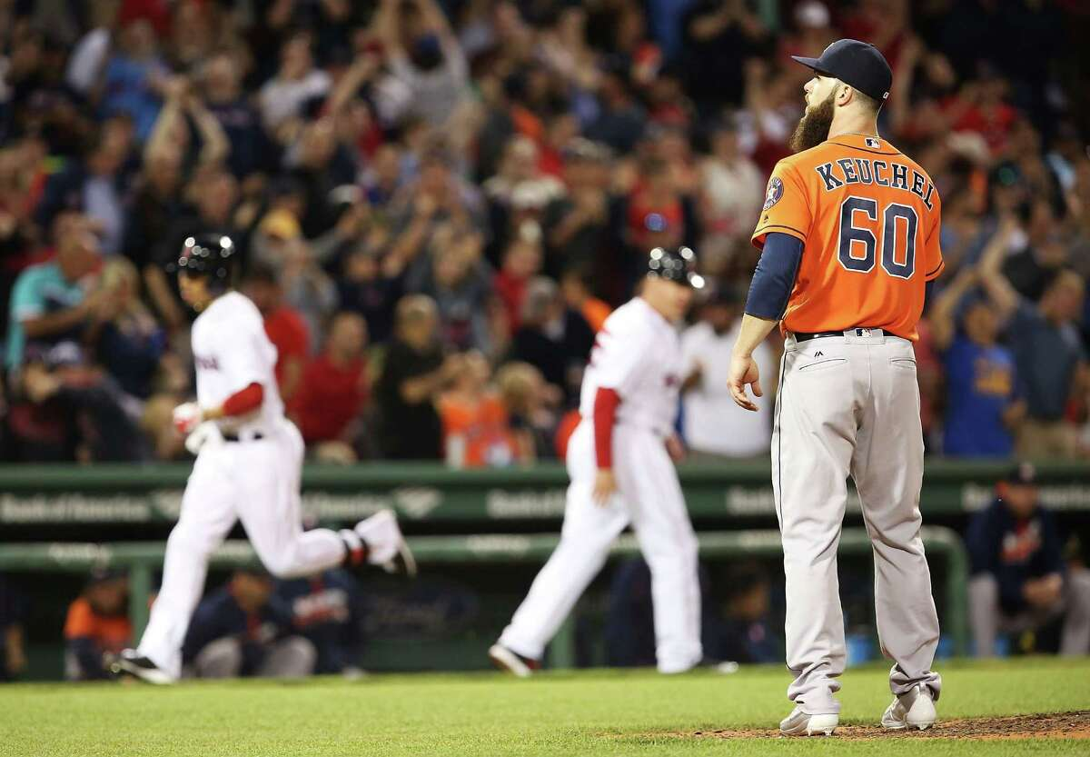 BOSTON, MA - MAY 12: Dallas Keuchel #60 of the Houston Astros looks on as Mookie Betts #50 of the Boston Red Sox rounds the bases after he hit a three-run home run in the sixth inning during the game against the Houston Astros at Fenway Park on May 12, 2016 in Boston, Massachusetts.