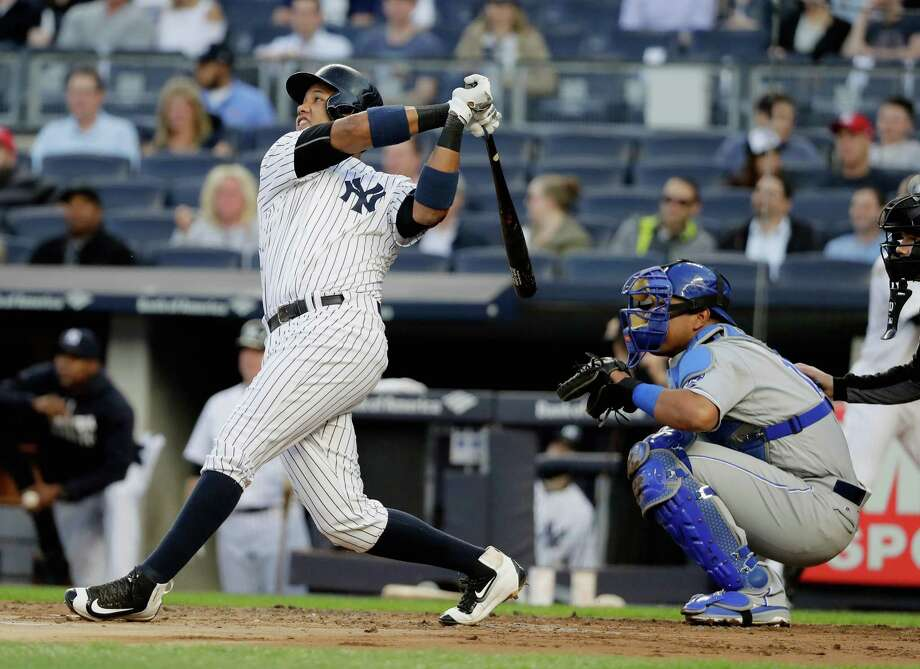 NEW YORK, NY - MAY 12:  Starlin Castro #14 of the New York Yankees hits a solo home run in the second inning against the Kansas City Royals during their game at Yankee Stadium on May 12, 2016 in New York City.  (Photo by Al Bello/Getty Images) ORG XMIT: 607677529 Photo: Al Bello / 2016 Getty Images