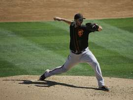 San Francisco Giants starting pitcher Clayton Blackburn throws against the Colorado Rockies during a spring training baseball game Sunday, March 20, 2016, in Scottsdale, Ariz. (AP Photo/Jae C. Hong)