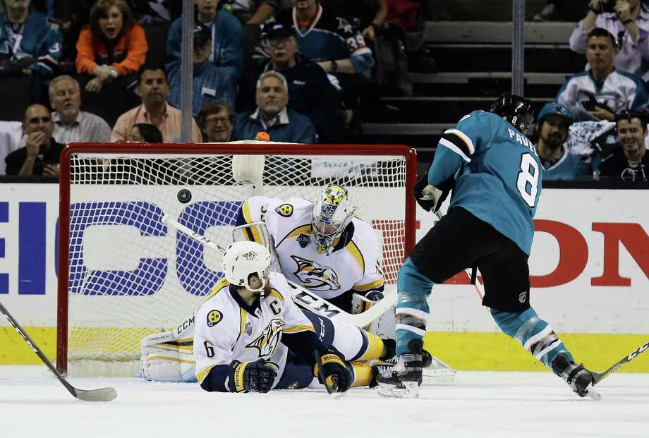 SAN JOSE, CA - MAY 12:  Joe Pavelski #8 of the San Jose Sharks scores a goal past Shea Weber #6 and goalie Pekka Rinne #35 of the Nashville Predators in the first period of Game Seven of the Western Conference Second Round during the 2016 NHL Stanley Cup Playoffs at SAP Center on May 12, 2016 in San Jose, California.  (Photo by Ezra Shaw/Getty Images) ORG XMIT: 634725903 Photo: Ezra Shaw / 2016 Getty Images