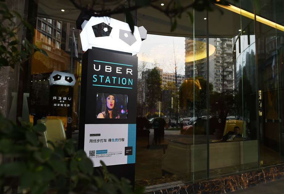 "An Uber Station is seen outside a hotel in Chengdu, in southwest China's Sichuan province on March 20, 2016.  China's transport minister warned online taxi-hailing companies on March 14 over subsidies leading to ""unfair"" competition, as US giant Uber and homegrown rival Didi spend billions in their battle for market share. / AFP PHOTO / GREG BAKERGREG BAKER/AFP/Getty Images Photo: GREG BAKER, AFP/Getty Images"