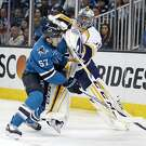 San Jose Sharks' Tommy Wingels is checked by Nashville Predators' Pekka Rinne during 2nd period  in Game 7 of NHL Stanley Cup Playoffs' Western Conference 2nd Round at SAP Center in San Jose, Calif., on Thursday, May 12, 2016.