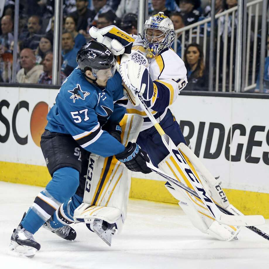 San Jose Sharks' Tommy Wingels is checked by Nashville Predators' Pekka Rinne during 2nd period  in Game 7 of NHL Stanley Cup Playoffs' Western Conference 2nd Round at SAP Center in San Jose, Calif., on Thursday, May 12, 2016. Photo: Scott Strazzante, The Chronicle