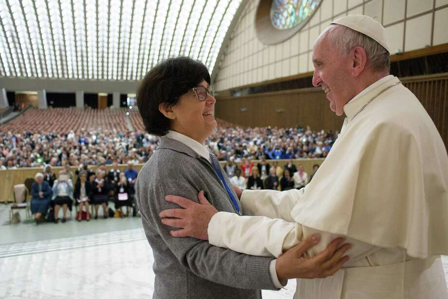 Pope Francis hugs Sister Carmen Sammut, a Missionary Sister of Our Lady of Africa at the end of a special audience with members of the International Union of Superiors General in the Paul VI Hall at the Vatican, Thursday, May 12, 2016. Pope Francis said Thursday he is willing to create a commission to study whether women can be deacons in the Catholic Church, signaling an openness to letting women serve in ordained ministry currently reserved to men.  (L'Osservatore Romano/Pool photo via AP) ORG XMIT: OSS102 / L'Osservatore Romano