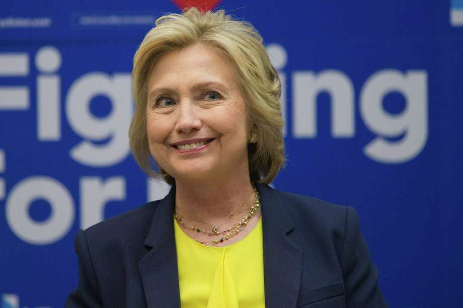 Democratic presidential candidate Hillary Clinton participates in a round table discussion with HIV/AIDS activists, Thursday, May 12, 2016, at he campaign headquarters in New York. (AP Photo/Mary Altaffer) ORG XMIT: NYMA104 Photo: Mary Altaffer / Copyright 2016 The Associated Press. All rights reserved. This m