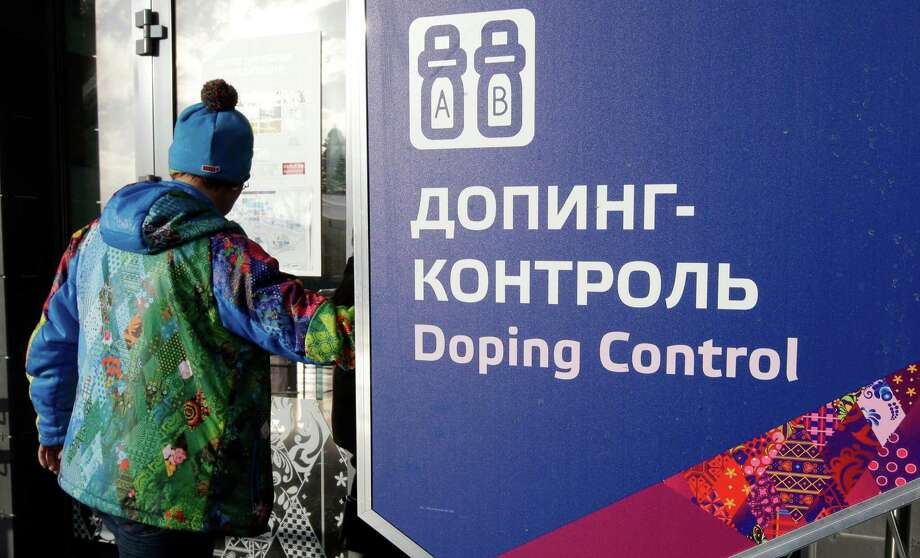 "FILE - In this Feb. 21, 2014, file photo, a man walks past a sign reading doping control, at the Laura biathlon and cross-country ski center, at the 2014 Winter Olympics in Krasnaya Polyana, Russia. The IOC ""would not hesitate"" to retest drug samples from the 2014 Winter Games in Sochi if there is evidence that doping controls were manipulated, according to the Olympic body's medical director. A Russian whistleblower told CBS' ""60 Minutes"" that four Russian gold medalists from the Sochi Olympics used steroids and Russian security agents worked as doping control officers during the games. (AP Photo/Lee Jin-man, File) ORG XMIT: NY172 Photo: Lee Jin-man / Copyright 2016 The Associated Press. All rights reserved. This m"