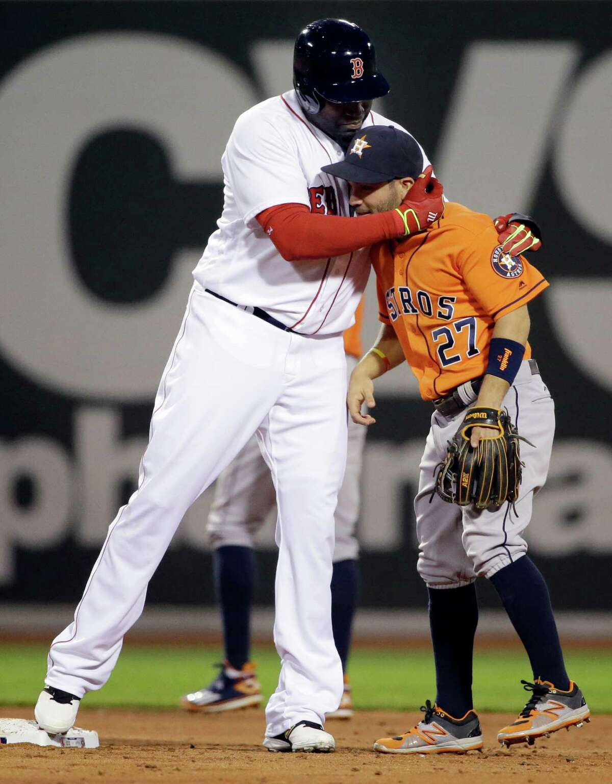 Who's your Papi? Red Sox designated hitter David Ortiz hugs Astros second baseman Jose Altuve, right, after doubling to lead off the bottom of the third inning Thursday night.