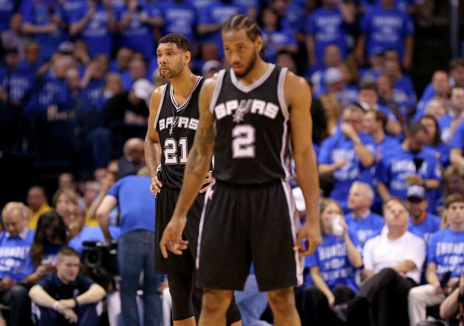 San Antonio Spurs' Tim Duncan and Kawhi Leonard pause during at timeout in first half action of Game 6 in the Western Conference semifinals against the Oklahoma City Thunder Thursday May 12, 2016 at Chesapeake Energy Arena in Oklahoma City, Oklahoma. Photo: Edward A. Ornelas, Staff / San Antonio Express-News / © 2016 San Antonio Express-News