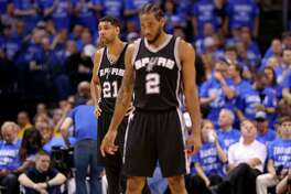 San Antonio Spurs' Tim Duncan and Kawhi Leonard pause during at timeout in first half action of Game 6 in the Western Conference semifinals against the Oklahoma City Thunder Thursday May 12, 2016 at Chesapeake Energy Arena in Oklahoma City, Oklahoma.