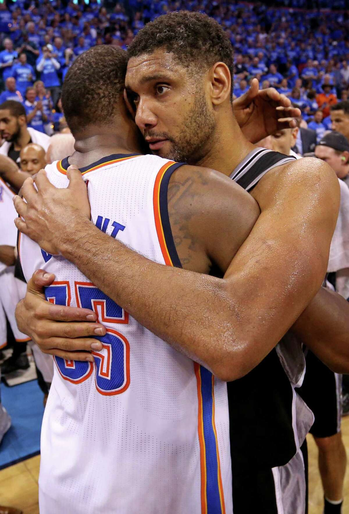 Oklahoma City Thunder's Kevin Durant and the Spurs' Tim Duncan hug after Game 6 in the Western Conference semifinals on May 12, 2016 at Chesapeake Energy Arena.