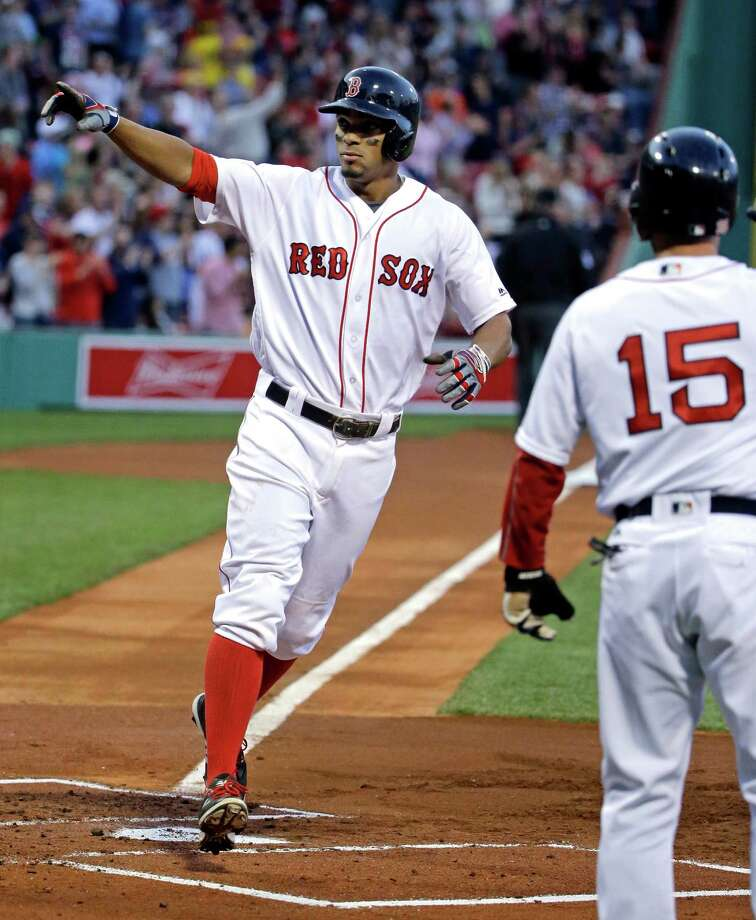 Boston Red Sox's Xander Bogaerts points to the fans as he crosses the plate after hitting a two-run home run, driving in Dustin Pedroia (15), during the first inning of a baseball game against the Houston Astros at Fenway Park, Thursday, May 12, 2016, in Boston. (AP Photo/Elise Amendola) ORG XMIT: MAEA105 Photo: Elise Amendola / Copyright 2016 The Associated Press. All rights reserved. This m
