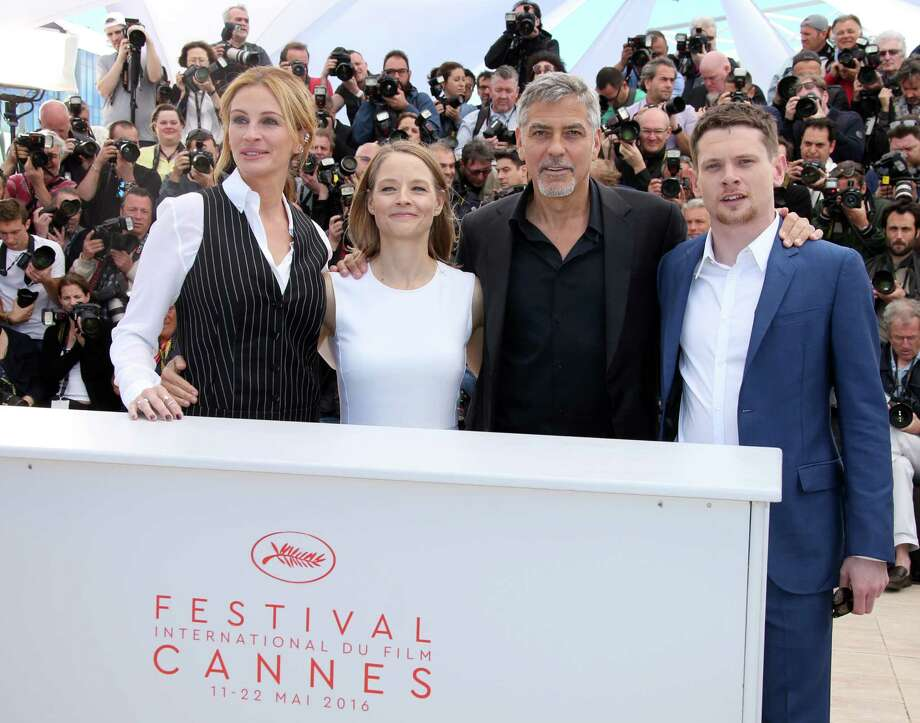 Director Jodie Foster, second left, poses for photographers with from left, actress Julia Roberts, actors George Clooney and Jack O'Connell, during a photo call for the film Money Monster at the 69th international film festival, Cannes, southern France, Thursday, May 12, 2016. (AP Photo/Joel Ryan) ORG XMIT: XCAN112 Photo: Joel Ryan / Invision
