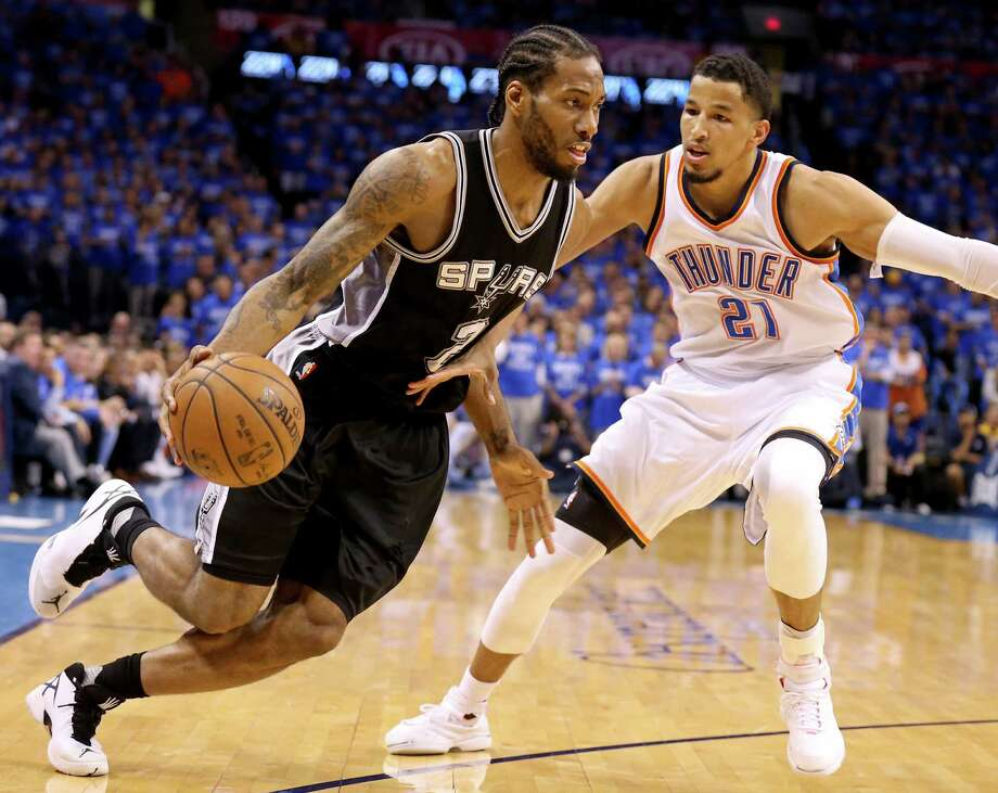 San Antonio Spurs' Kawhi Leonard drives around Oklahoma City Thunder's  Andre Roberson during second half