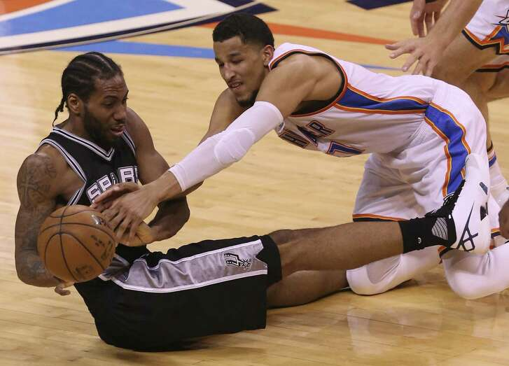 San Antonio Spurs' Kawhi Leonard and Oklahoma City Thunder's Andre Roberson scramble for a rebound in the second half of game six in the Western Conference semi finals at the Chesapeake Energy Arena in Oklahoma City, Thursday, May 12, 2016. The Thunder won, 113-99 to take the series, 4-2.