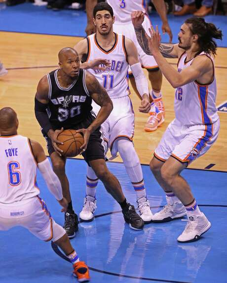 San Antonio Spurs' David West is defended by Oklahoma City Thunder's from left, Randy Foye, Enes Kanter and Steven Adamsin the first half of game six in the Western Conference semi finals at the Chesapeake Energy Arena in Oklahoma City, Thursday, May 12, 2016. The Thunder leads the series, 3-2. Photo: JERRY LARA, Staff / San Antonio Express-News / © 2016 San Antonio Express-News