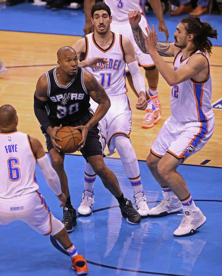 San Antonio Spurs' David West is defended by Oklahoma City Thunder's from left, Randy Foye, Enes Kanter and Steven Adamsin the first half of game six in the Western Conference semi finals at the Chesapeake Energy Arena in Oklahoma City, Thursday, May 12, 2016. The Thunder leads the series, 3-2.