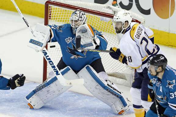 San Jose Sharks' Martin Jones eyes the puck as Nashville Predators' Paul Gaustad watches during 3rd period of Sharks' 5-0 win in Game 7 of NHL Stanley Cup Playoffs' Western Conference 2nd Round at SAP Center in San Jose, Calif., on Thursday, May 12, 2016.