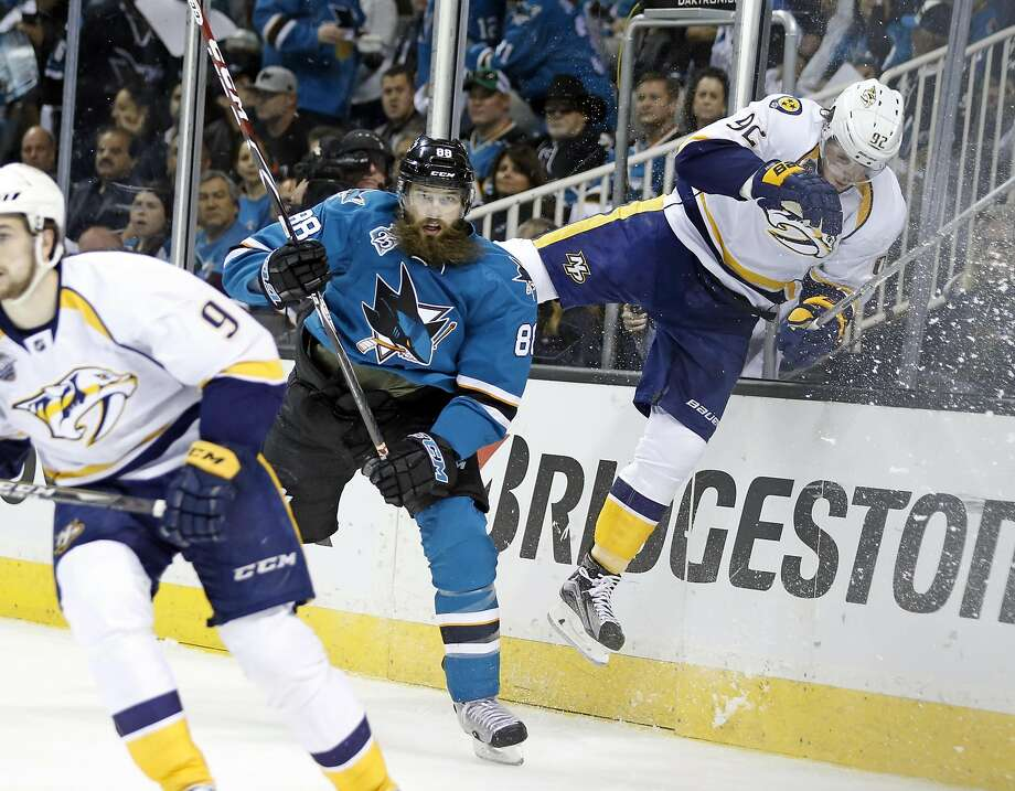 San Jose Sharks' Brent Burns sends Nashville Predators' Ryan Johansen flying during 1st period of Sharks' 5-0 win in Game 7 of NHL Stanley Cup Playoffs' Western Conference 2nd Round at SAP Center in San Jose, Calif., on Thursday, May 12, 2016. Photo: Scott Strazzante, The Chronicle