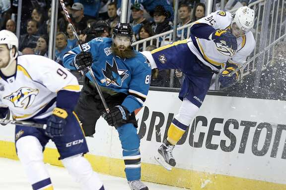 San Jose Sharks' Brent Burns sends Nashville Predators' Ryan Johansen flying during 1st period of Sharks' 5-0 win in Game 7 of NHL Stanley Cup Playoffs' Western Conference 2nd Round at SAP Center in San Jose, Calif., on Thursday, May 12, 2016.