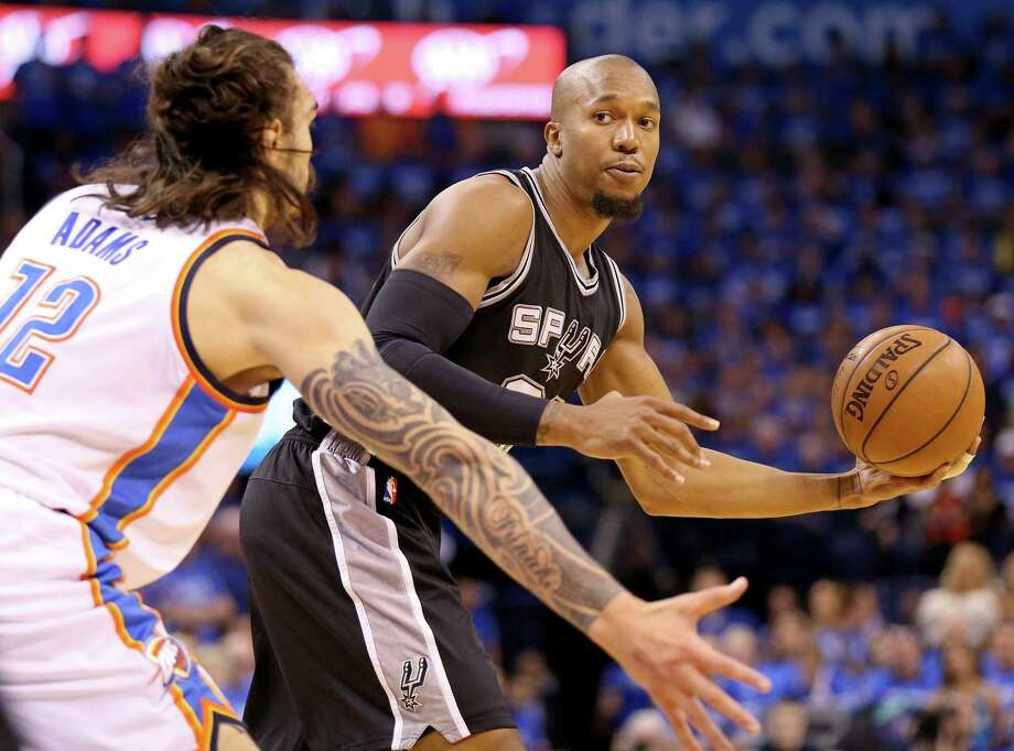Spurs' David West looks to pass around Oklahoma City Thunder's Steven Adams during first half action of Game 6 in the Western Conference semifinals on May 12, 2016 at Chesapeake Energy Arena. Photo: Edward A. Ornelas /San Antonio Express-News / © 2016 San Antonio Express-News