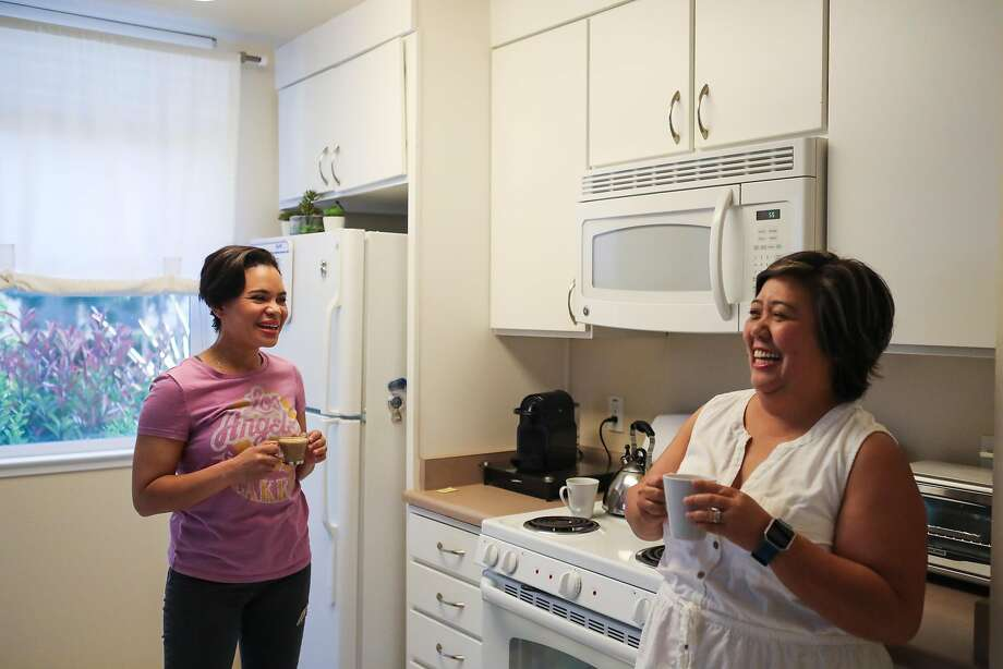 Middle school teachers Reyna Jones (left) and Raquel Arcinas Clark drink coffee in Jones' kitchen at Casa del Maestro in Santa Clara, which offers subsidized apartments for educators. Photo: Gabrielle Lurie, Special To The Chronicle