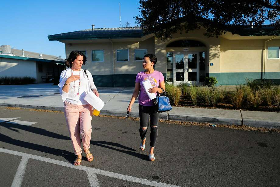 Teacher Reyna Jones (right) walks out of Cabrillo Middle School with colleague Jeannie Ambrose (left) after a school counsel meeting in Santa Clara. Photo: Gabrielle Lurie, Special To The Chronicle