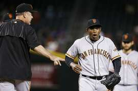 San Francisco Giants' Santiago Casilla, right, shouts after being pulled from the baseball game by manager Bruce Bochy, left, during the ninth inning against the Arizona Diamondbacks on Thursday, May 12, 2016, in Phoenix. The Giants defeated the Diamondbacks 4-2. (AP Photo/Ross D. Franklin)