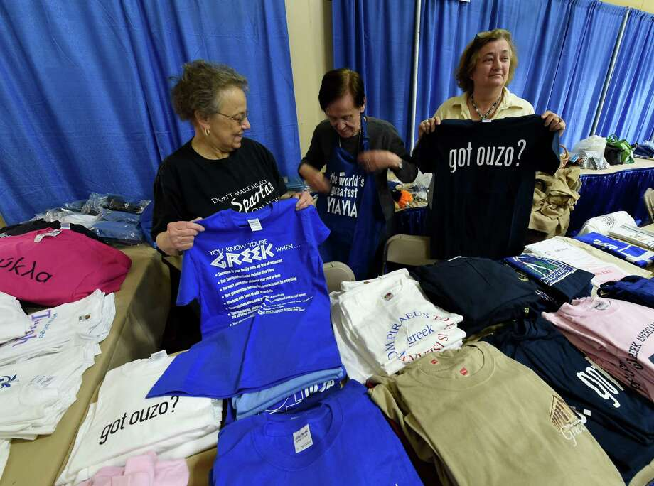 Karen Takes Pappis, left, Helen Markopoulis, center and Olga Antonput out t-shirts for sale in preparation for the St. Sophia's Church Greek Festival Thursday May 12, 2016 In Albany, N.Y.  The festival will run from this Friday through Sunday and will feature ethnic foods and entertainment.  Some of the foods that will be sold to benefit the church will be Stifatho, Leg of Lamb, Moussaka, Pastichio, Stuffed Peppers, Spanakopita and tiropeta and over 20,000 home made pastries. (Skip Dickstein/Times Union) Photo: SKIP DICKSTEIN / 20036560A