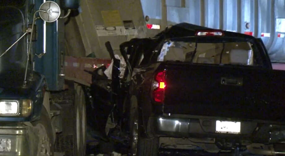 A man died early Friday morning when his pickup slammed in the side of a big-rig in northeast Harris County. Photo: Metro Video