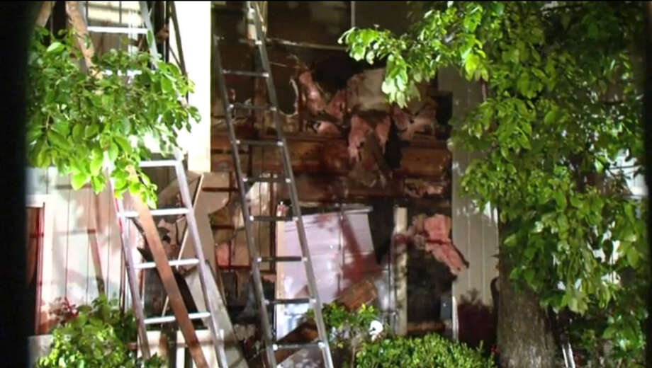 Two families are safe but they likely lost much of their belongings after fire raced through a few apartments Thursday night in northwest Houston. Photo: Metro Video