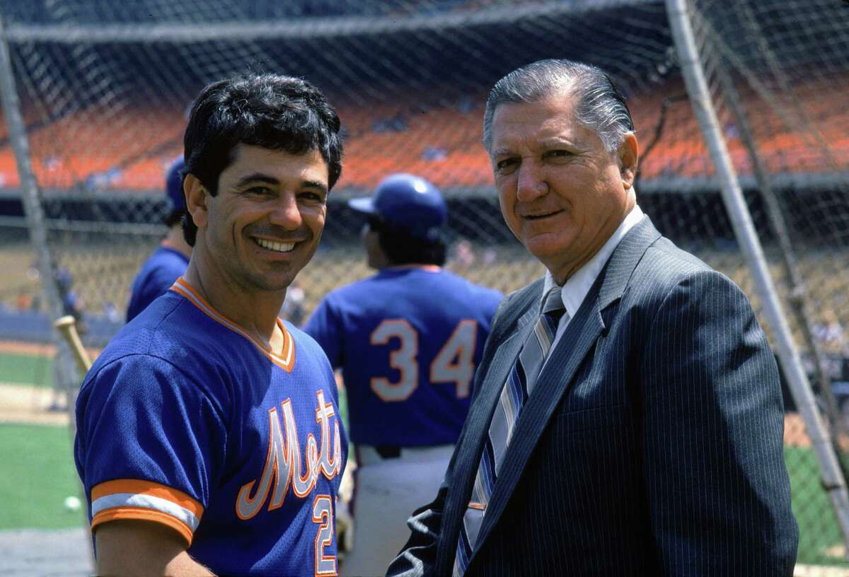 New York Mets coach Bobby Valentine poses for a photo with General Manager Al Campanis of the Los Angeles Dodgers before a May 1984 game at Dodger Stadium in Los Angeles, California.