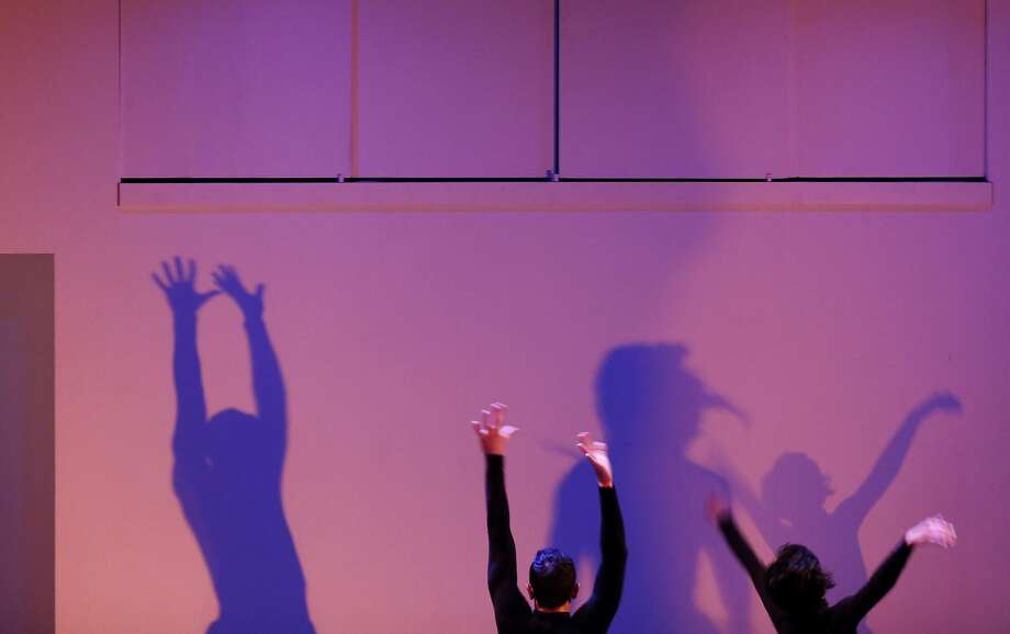 """Dancers perform with their shadows in """"(Dis)integration"""" by Fact/SF. Photo: Connor Radnovich, The Chronicle"""