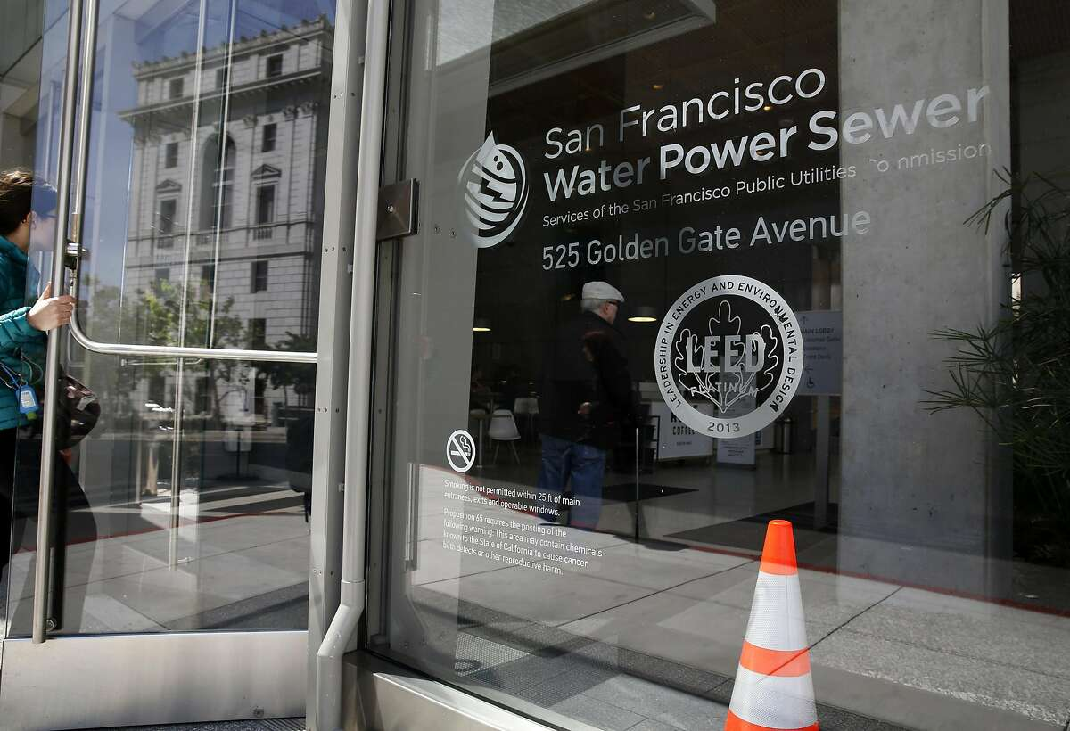 People enter the LEED certified Public Utilities Commission building at 525 Golden Gate Ave in San Francisco, California, on Thursday, May 12, 2016.