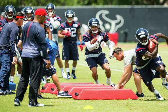 Houston Texans wide receiver Will Fuller runs over a line of blocking dummies during a drill at rookie mini camp at The Methodist Training Center on Saturday, May 7, 2016, in Houston. ( Brett Coomer / Houston Chronicle )