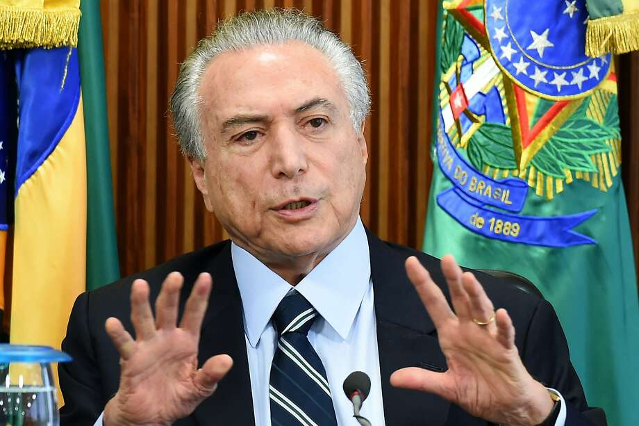 Brazilian acting President Michel Temer seeks to resuscitate the economy and reform a costly pension system that allows many people to retire in their 50s. Photo: EVARISTO SA, AFP/Getty Images