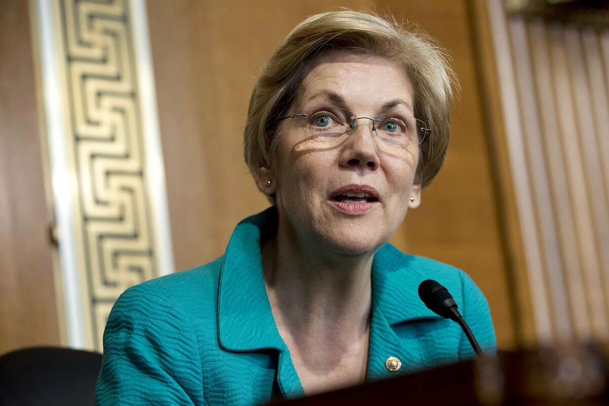 """In this photo taken Oct. 6, 2015, Sen. Elizabeth Warren, D-Mass. speaks on Capitol Hill in Washington. Warren has taken to Twitter again to bash Donald Trump, the latest in a series of Internet """"tweetstorms"""" calling Trump on the carpet for his treatment of women and his insults toward her. (AP Photo/Jacquelyn Martin)"""
