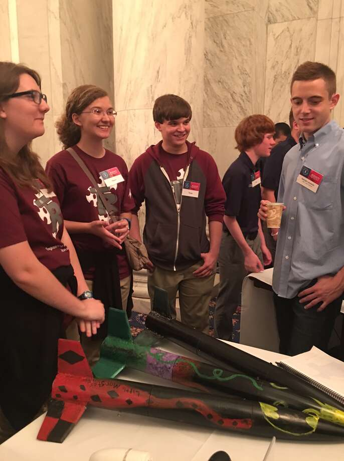 Roosevelt High School students Caylee Davis, Ana Wilson, Ethan Bracy show off their rockets on Friday, May 13, 2016 at the Russell Senate Office Building in Washington D.C. They were among 100 teams nationwide to qualify to compete in the Team America Rocket Challenge, set for Saturday. Photo: Courtesy
