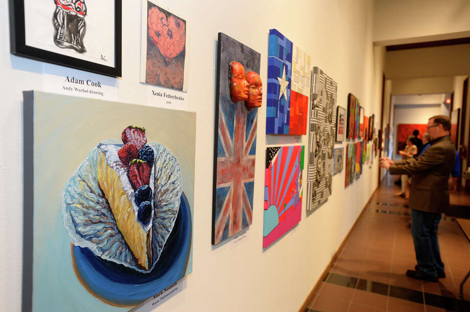 Art displayed on the walls during the 2016 Treasure Auction at the Art Museum of Southeast Texas on Thursday evening. Local artists created pop art themed pieces to be auctioned off to raise money for the museum.  Photo taken Thursday 5/12/16 Ryan Pelham/The Enterprise Photo: Ryan Pelham / ©2016 The Beaumont Enterprise/Ryan Pelham