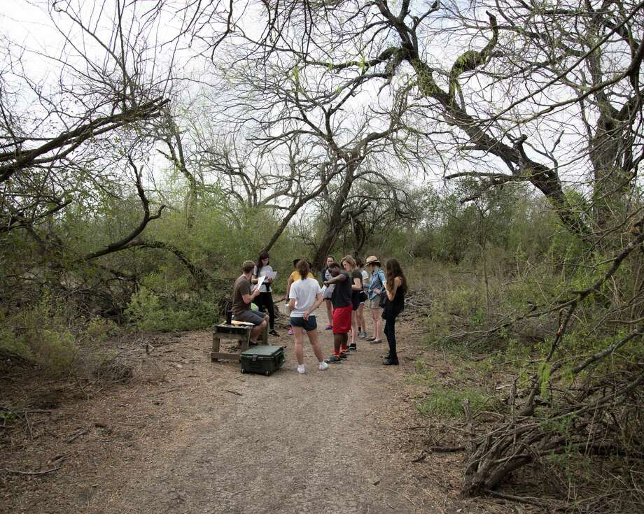 Students have a dialogue with their instructor within the Santa Ana Wildlife Refuge in McAllen, Texas. Photo: Photos By Jason Reed /For The San Antonio Express-News / Jason Reed
