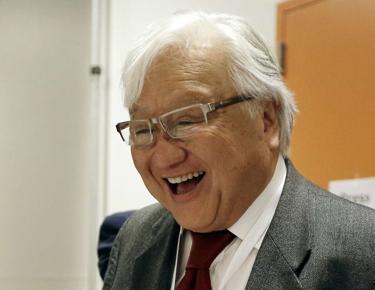 FILE - In this Feb. 27, 2016 file photo, Rep. Mike Honda, D-Calif., smiles while speaking with a supporter during a break in the California Democrats State Convention in San Jose. Honda will face several challengers from three parties in the California Primary on June 7, 2016.(AP Photo/Ben Margot, File)