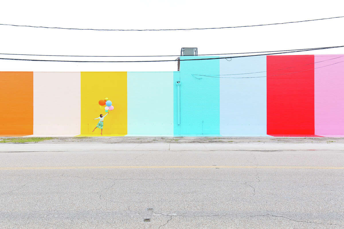 Ashley Rose created the Sugar & Cloth Color Wall on Canal Street.