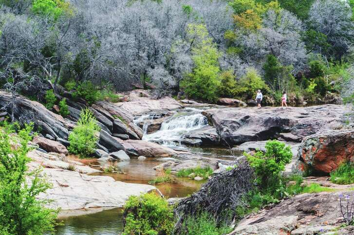 Hiking in Burnet County is a relaxing pastime, with heavy vegetation and rock formations.