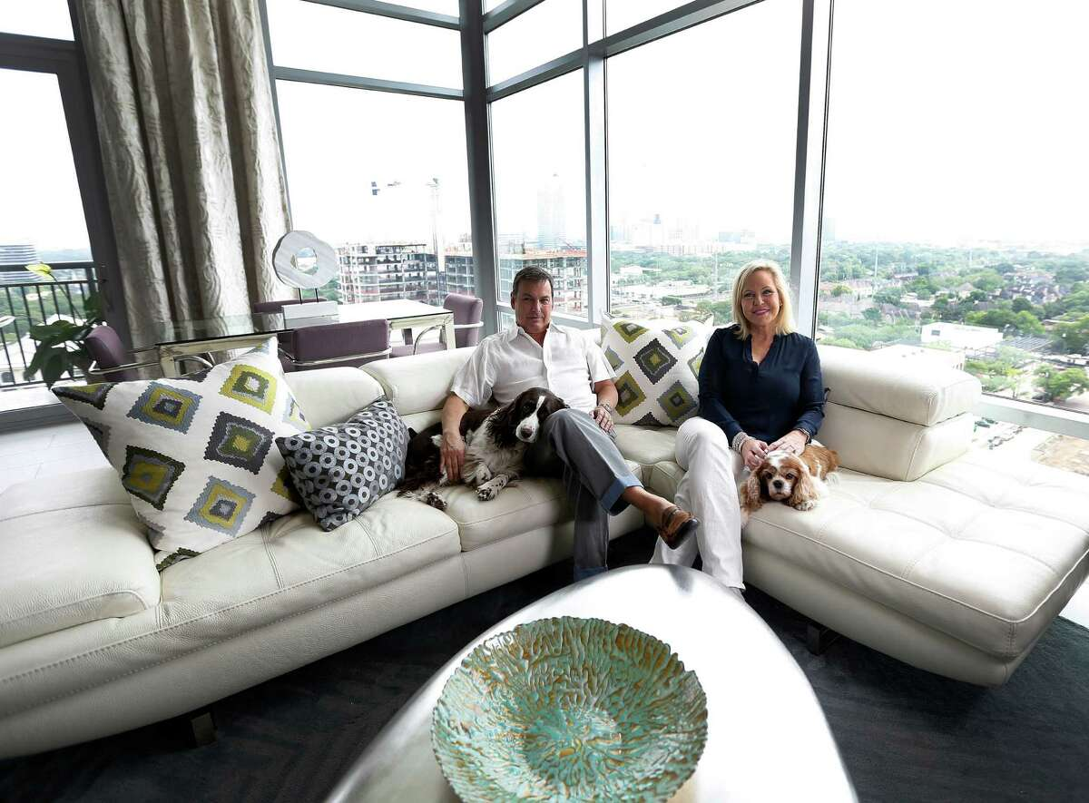 Kathy Frazar and Tom Hedge, as well as dogs Hallie and Lizzi, left their West U two-story home behind for the sleek, modern feel of their new Highland Tower penthouse.